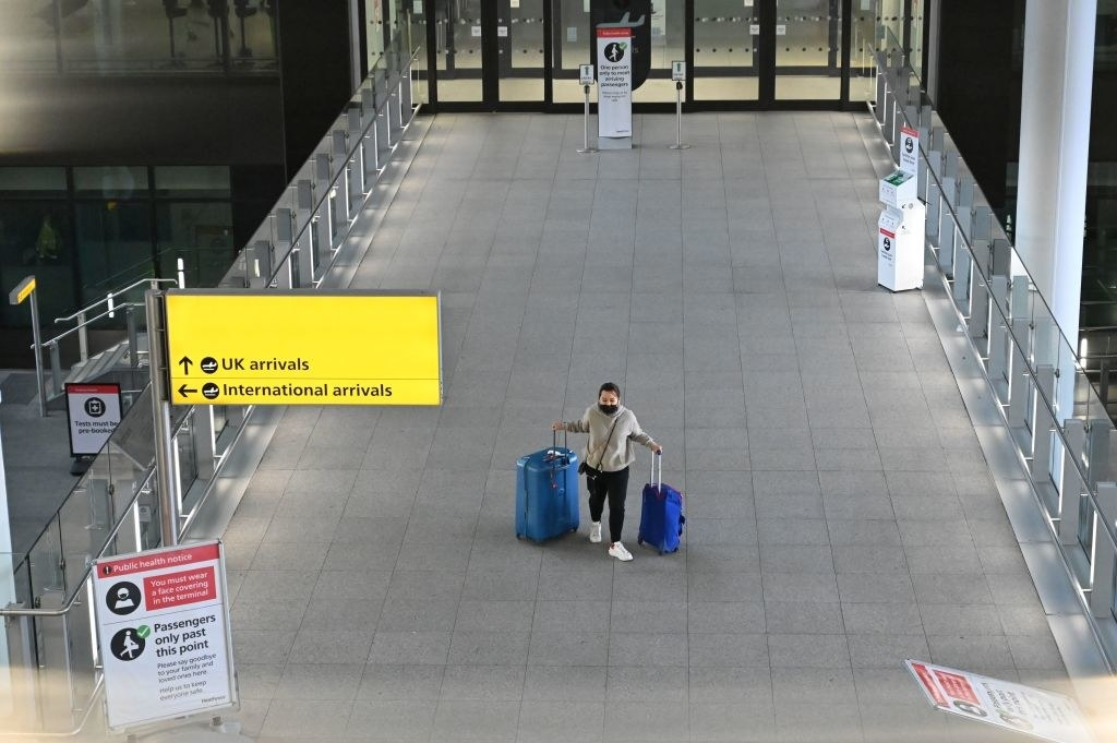 Traveler walking through empty section of London's airport