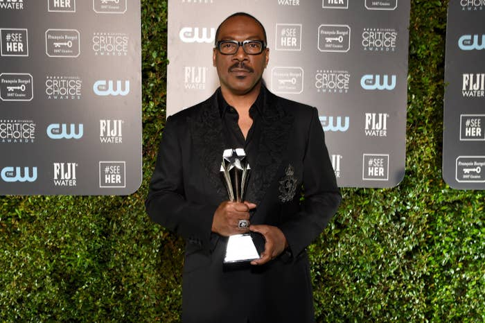 Eddie Murphy holding a trophy at the Critics' Choice Awards in Santa Monica in 2020