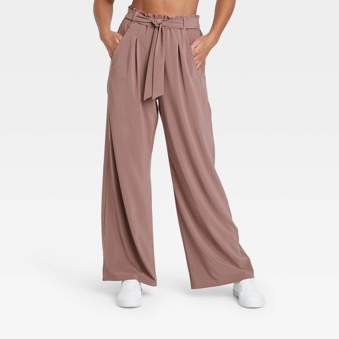 model in wide leg stretch pants with sneakers