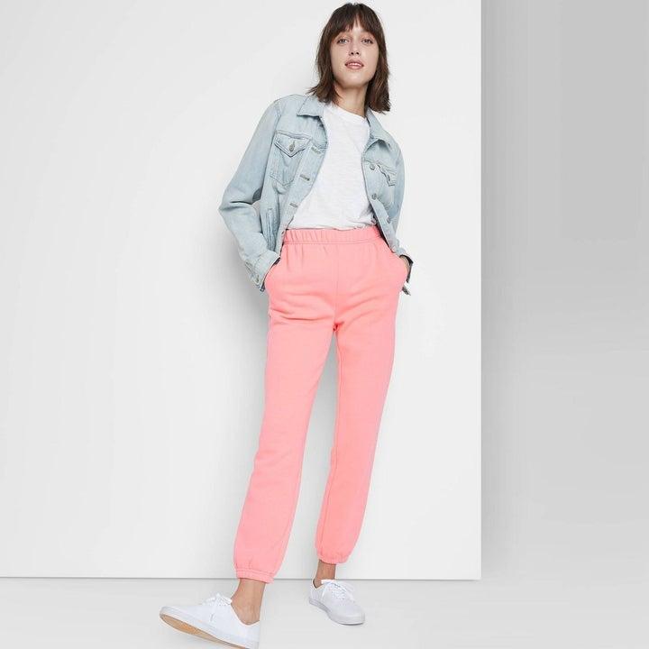model in pink sweatpants