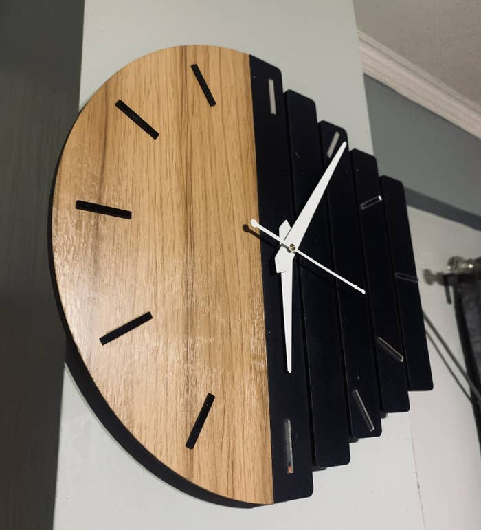 Wall clock hung on the wall.