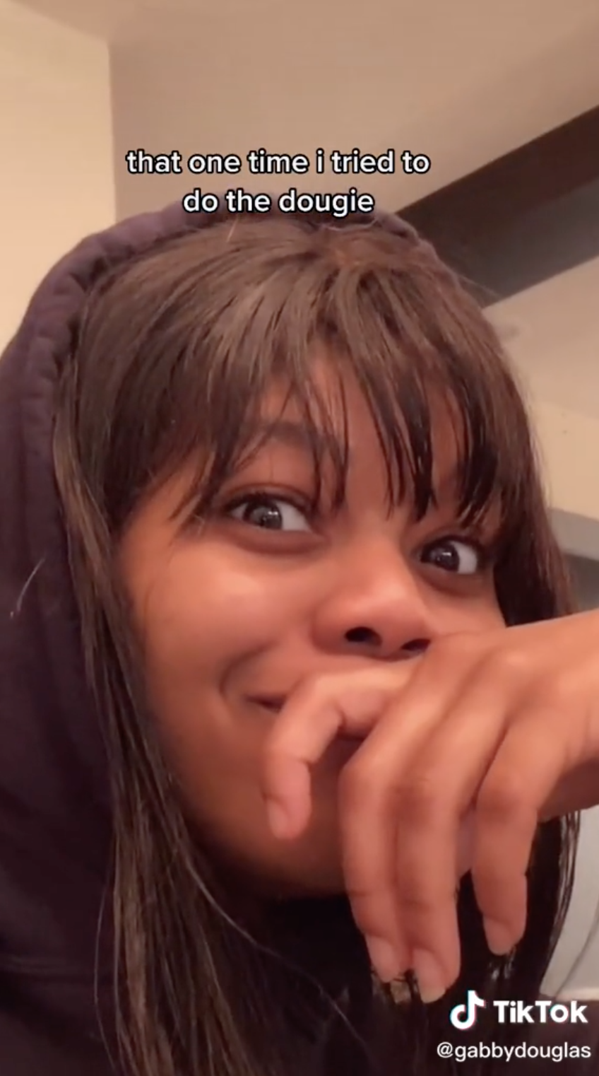 Gabby Douglas stares at the camera with wide eyes