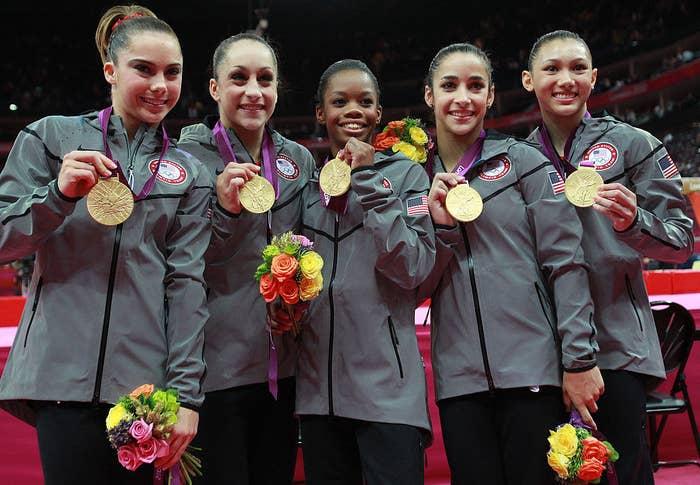 Mc Kayla Maroney, Jordyn Wieber, Gabrielle Douglas, Alexandra Raisman and Kyla Ross of the United States celebrate after winning the gold medal in the Artistic Gymnastics Women's Team
