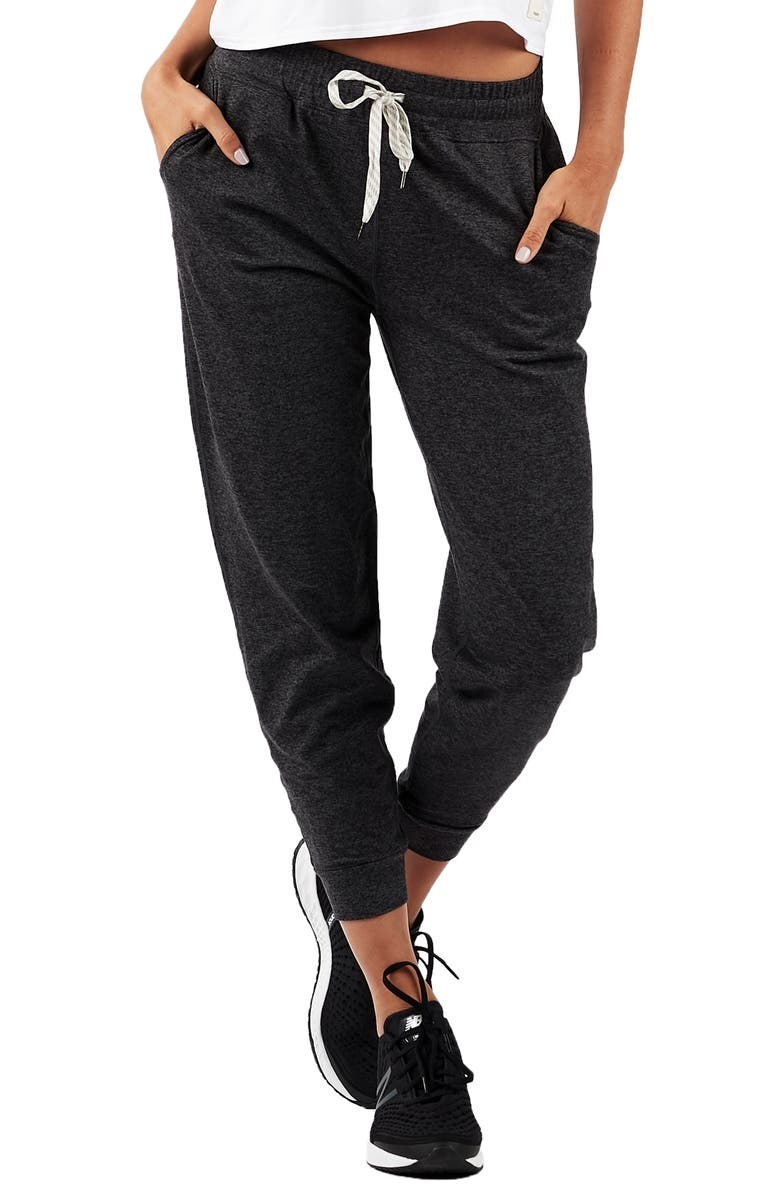 A model wears the joggers in Charcoal Heather