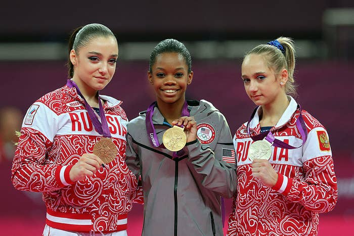 Bronze medalist Aliya Mustafina of Russia, gold medalist Gabrielle Douglas of the United States and silver medalist Victoria Komova of Russia pose after the medal ceremony at the 2012 Olympics