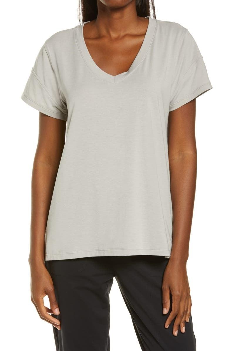 A model wears the T-shirt in Grey Porpoise
