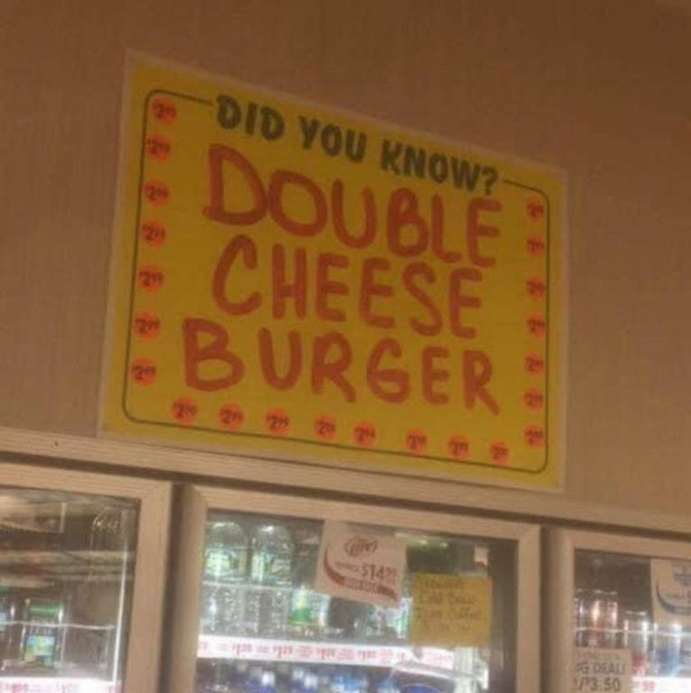 sign reading did you know double cheeseburger