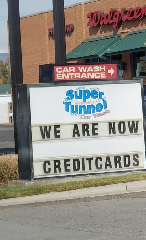 sign reading we are now credit cards