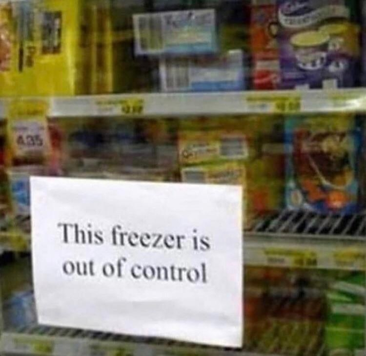 sign reading this freezer is out of control on a store frozen section door