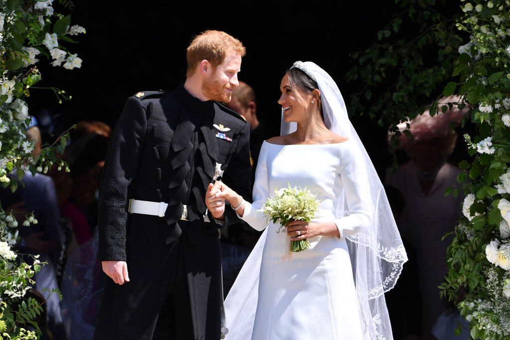 Harry and Meghan smiling as they exit the church on their wedding day