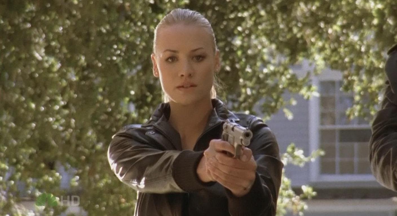 "Yvonne in ""Chuck"" holding a gun"