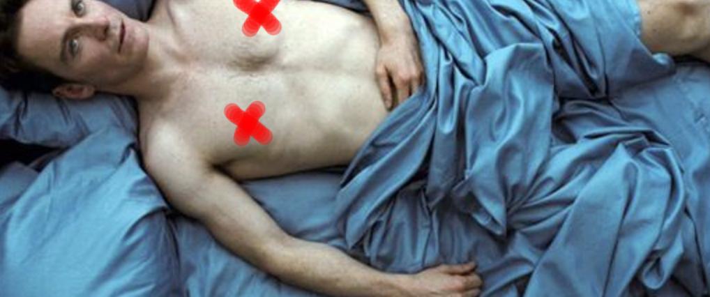 "Michael Fassbender shirtless on a bed in ""Shame"""
