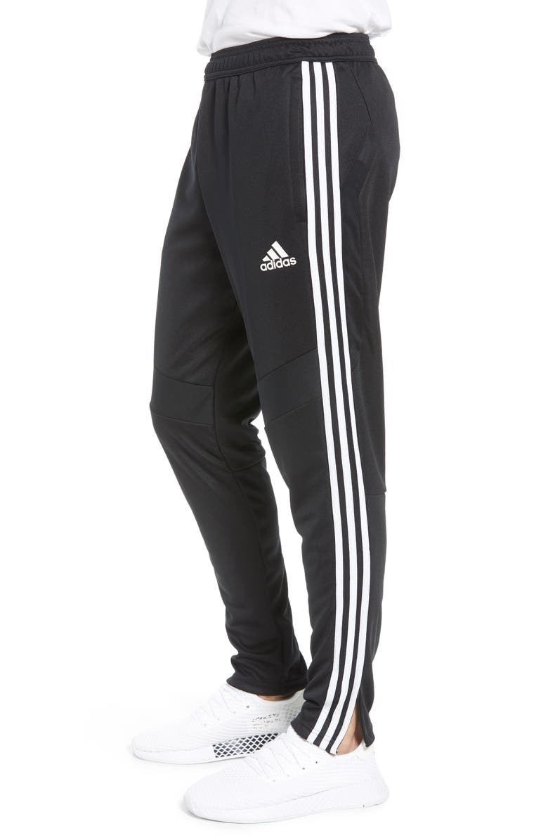 A model wears the pants in Black/White