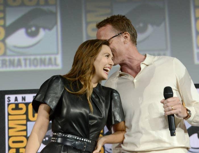 Paul Bettany whispering to Elizabeth Olsen