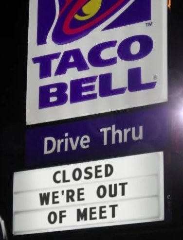 sign reading closed we're out of meet below Taco Bell logo