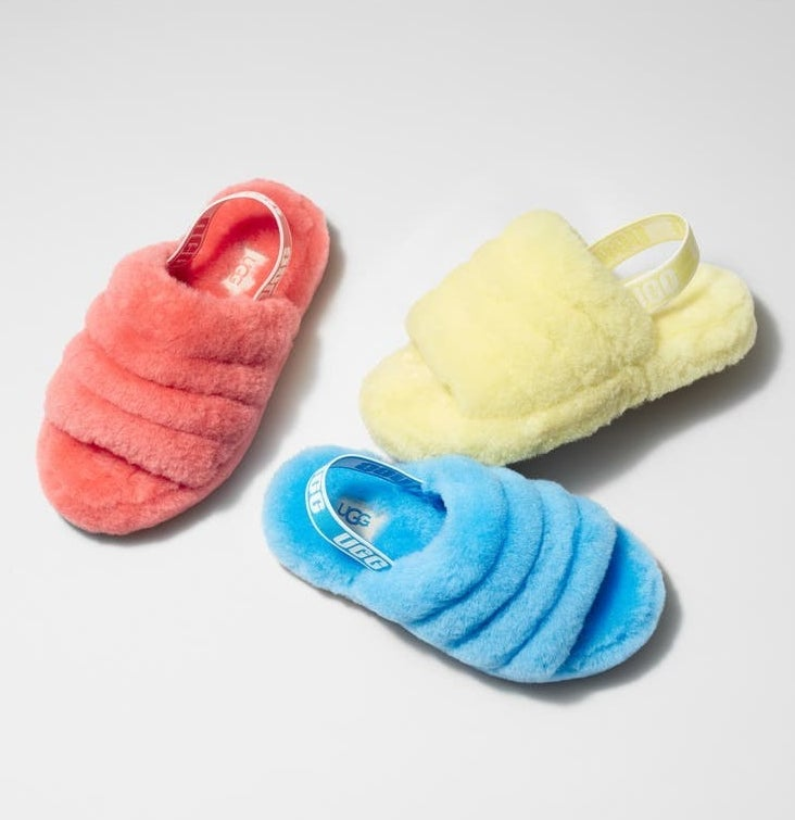The sandals in pink, blue, and yellow