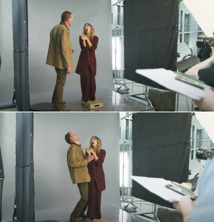 Elizabeth Olsen pointing at Paul Bettany and making him laugh