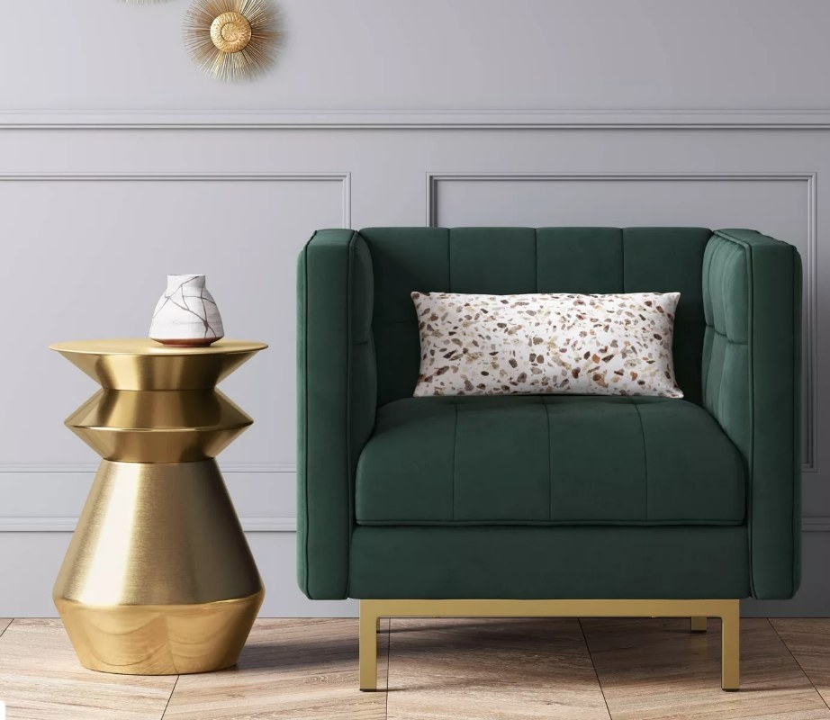 Gold end table next to green chair