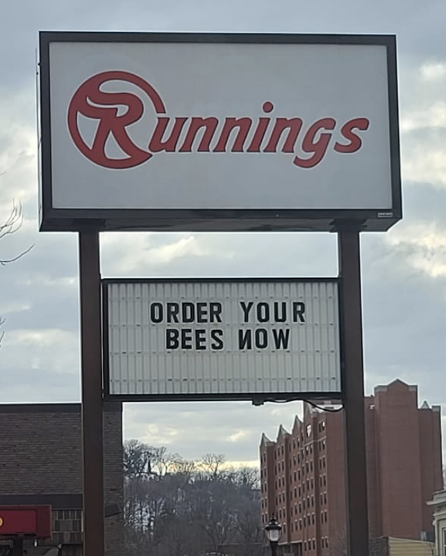 sign reading order your bees now below a Runnings logo