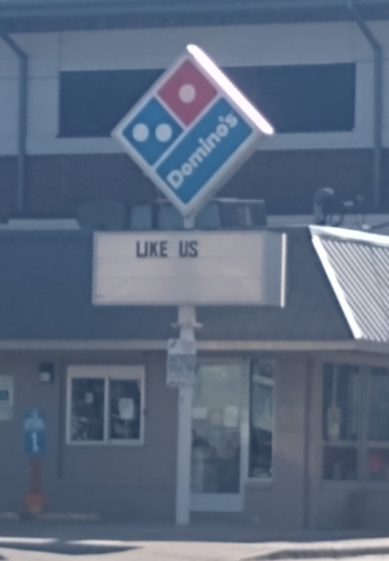 sign reading like us below a Domino's logo