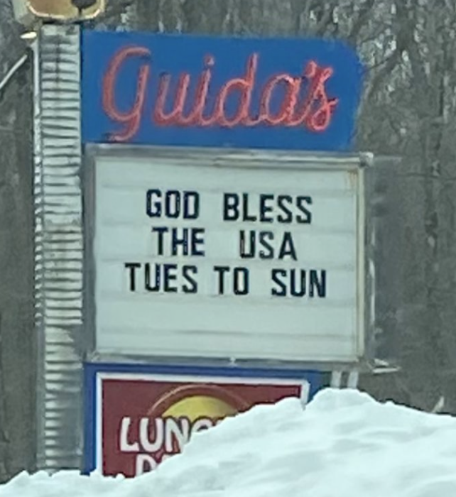 sign reading god bless the usa tues to sun