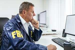 An FBI agent looking at a computer screen