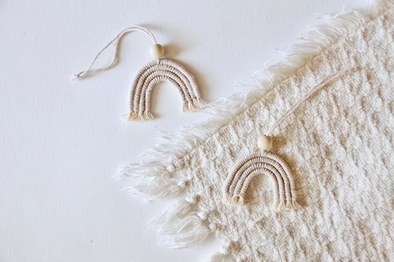 Two macrame essential oil charms with a wooden bead on each