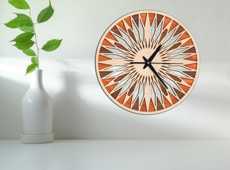 a numberless and bright circular clock made up of geometric shapes