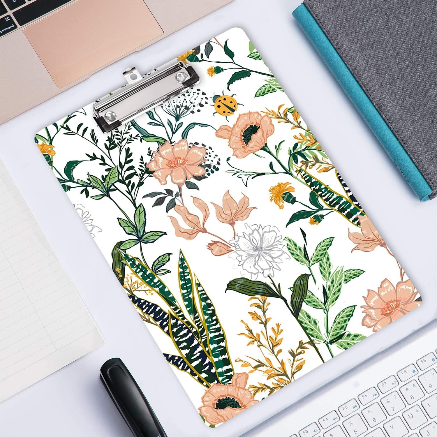 A floral clipboard on a desk