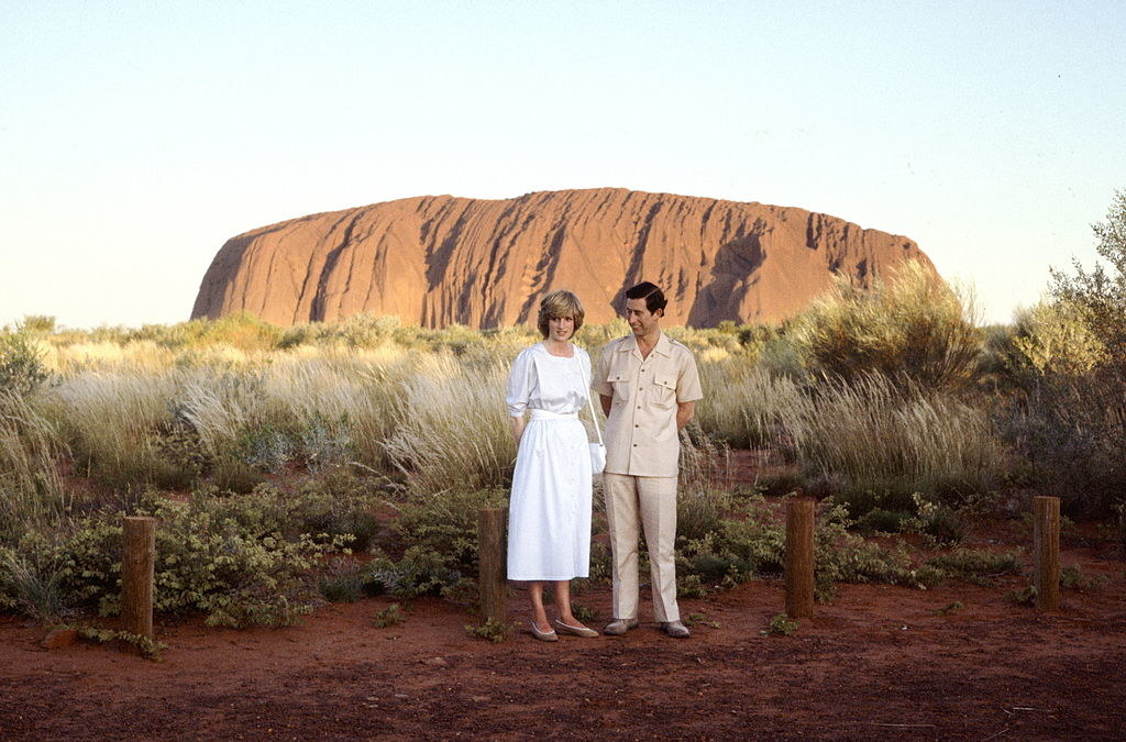 Diana and Charles standing in front of Uluru