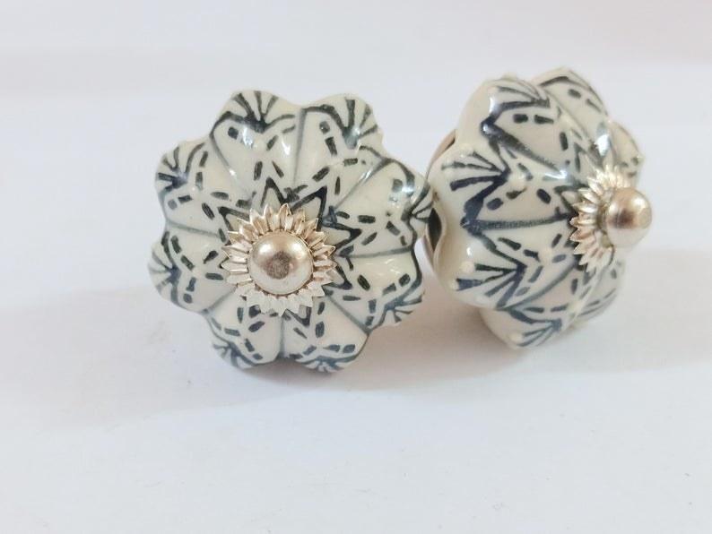 Two elegant ceramic cupboard knobs