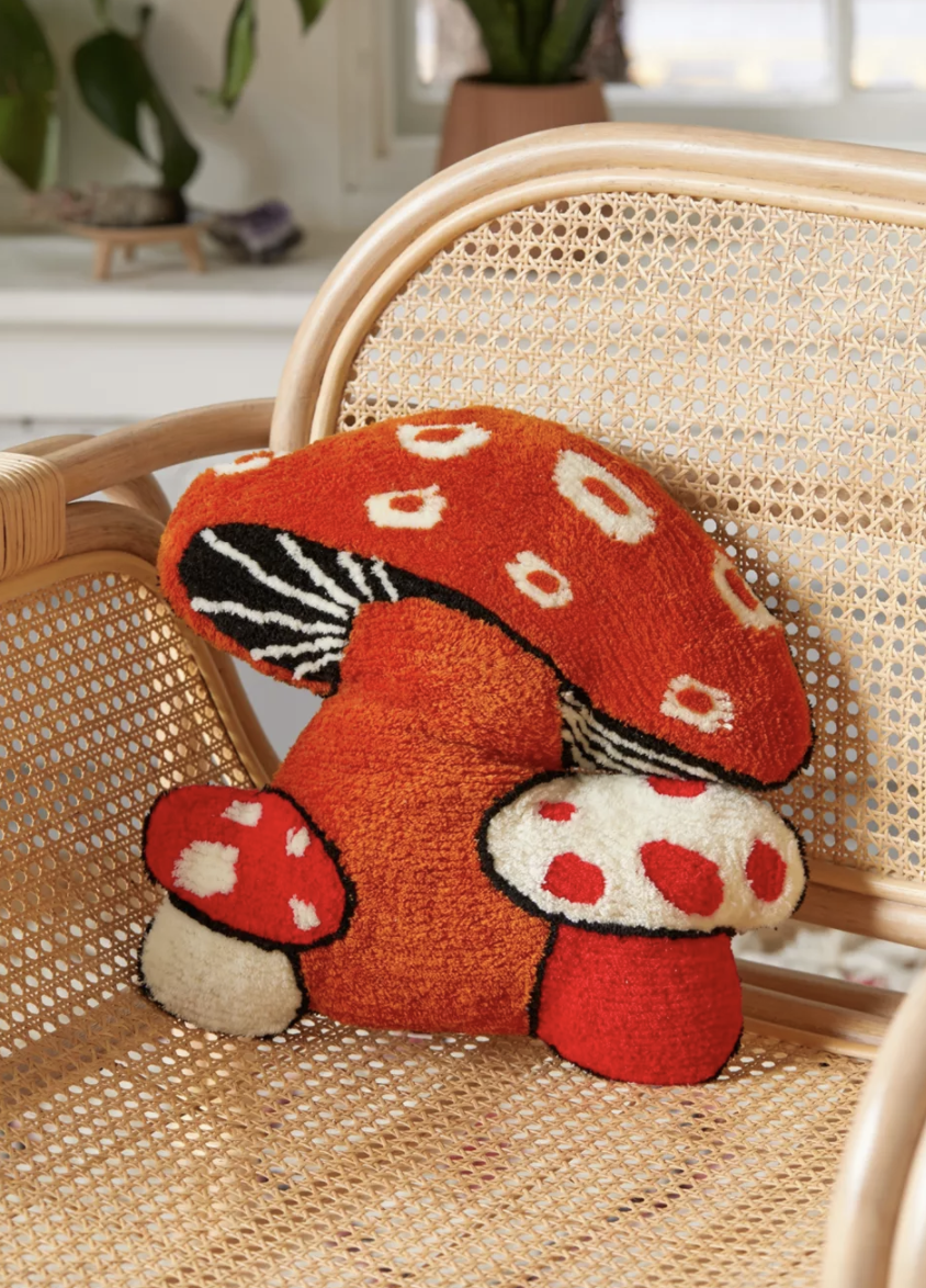 tufted mushroom pillow on chair