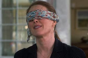 A woman with a blindfold on