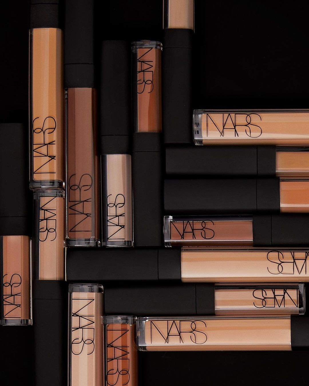 A bunch of thin tubes of concealer in a pile