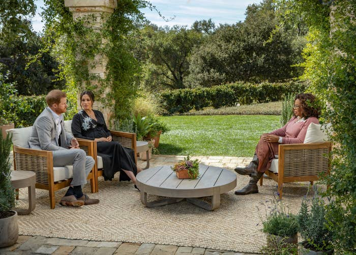 Harry, Meghan, and Oprah sitting in an outdoor setting for their interview