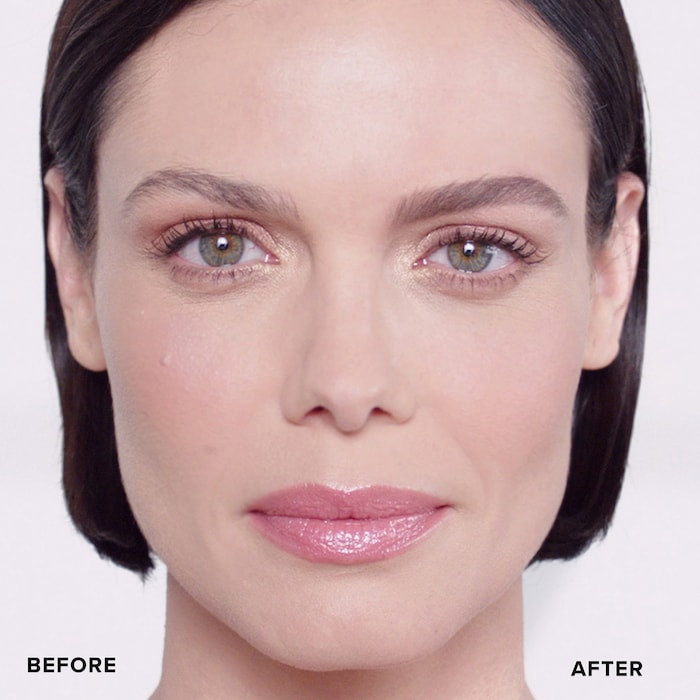 A person with one regular brow and one brow that's been filled in