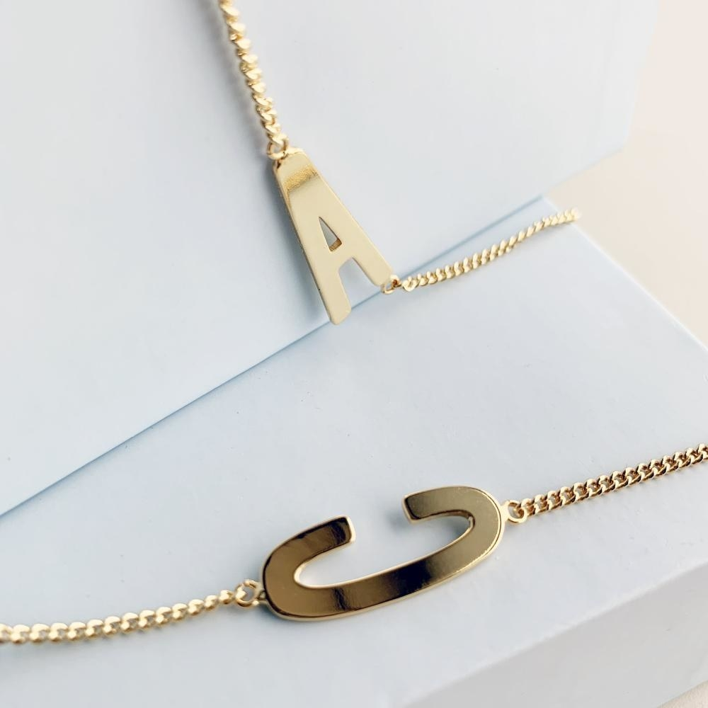 gold A and C chain necklace