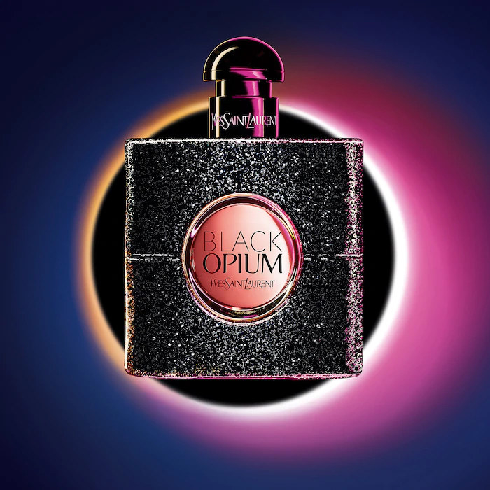 A large square-shaped bottle of perfume with a round top
