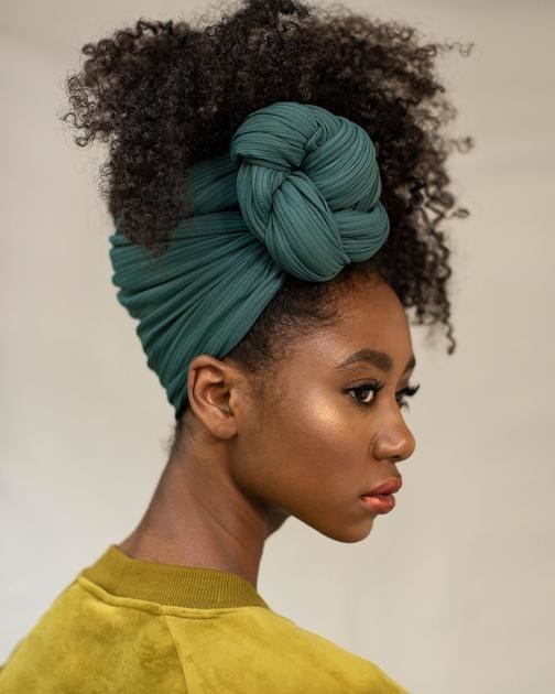 model wears evergreen wrap in their hair