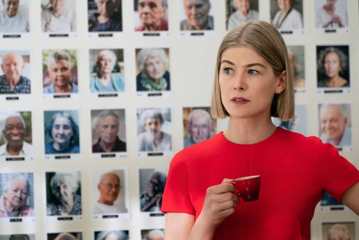 Rosamund Pike holds a tiny coffee cup in I Care A Lot