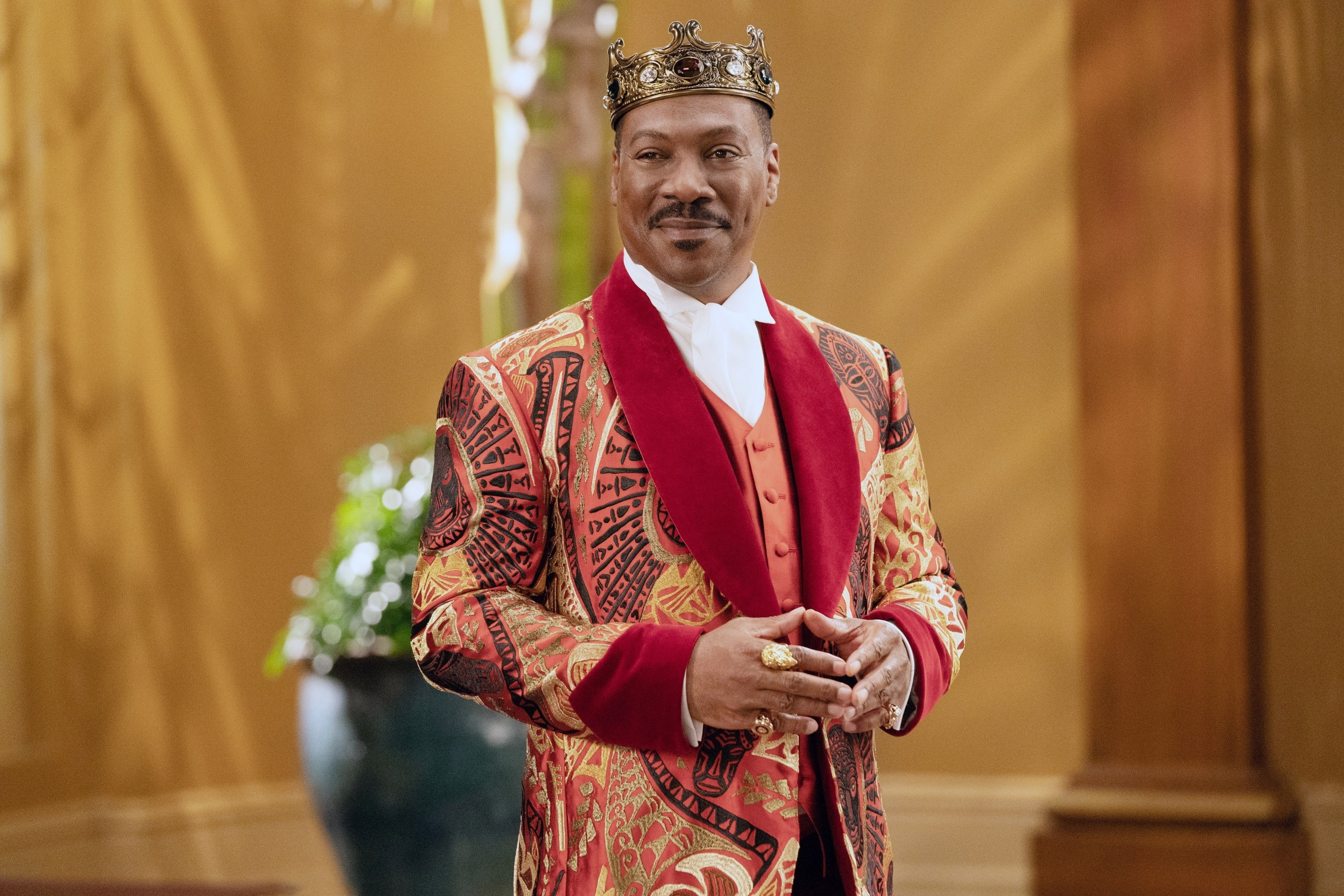 Eddie Murphy dressed in royal garb and a crown in Coming 2 America