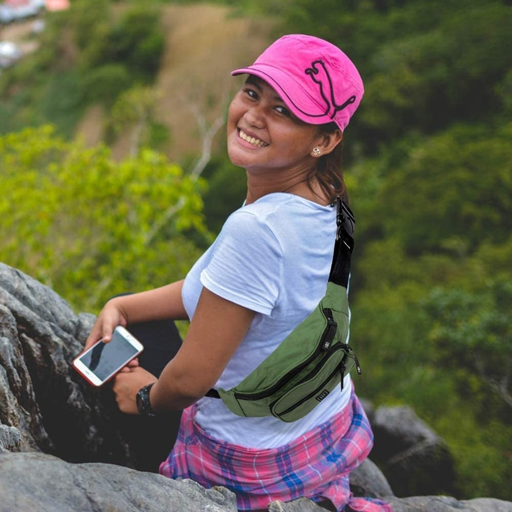 the fanny pack in green with a hiker