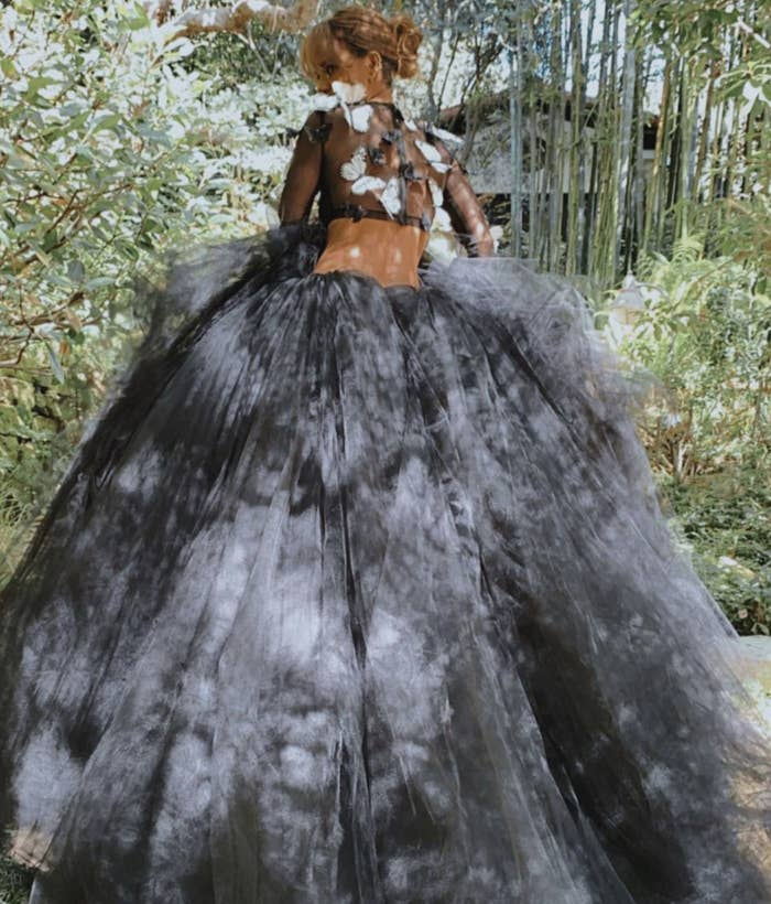 Hall shows off her black tulle princess skirt from behind