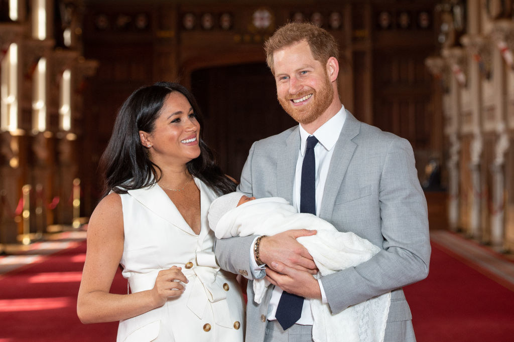 Prince Harry and Meghan pose with their newborn son Archie during a photocall in St George's Hall at Windsor Castle