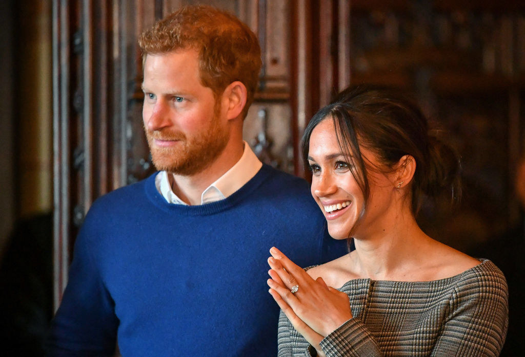 Prince Harry (L) and Meghan Markle watch a performance by a Welsh choir in the banqueting hall during a visit to Cardiff Castle Cardiff, Wales
