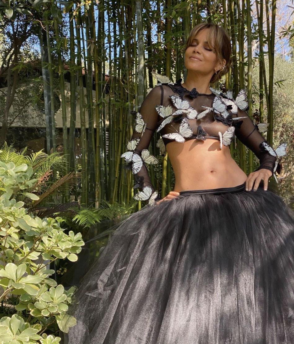Halle wears a sheer crop top covered in butterflies showing off her incredible figure