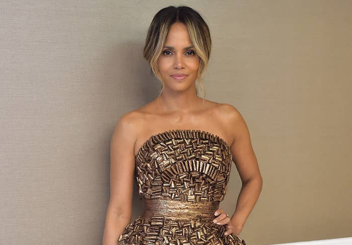 Halle poses a pre-pandemic event in a gold strapless gown
