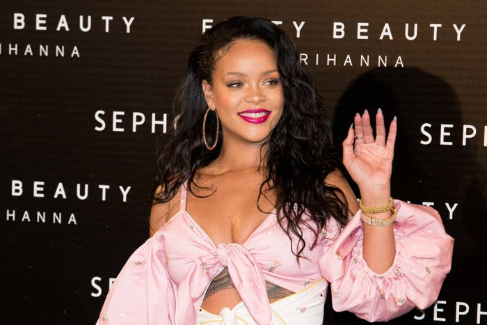 Rihanna waves at a Fenty Beauty event