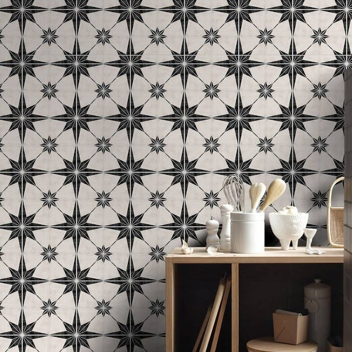 black and white tile decals on a kitchen wall