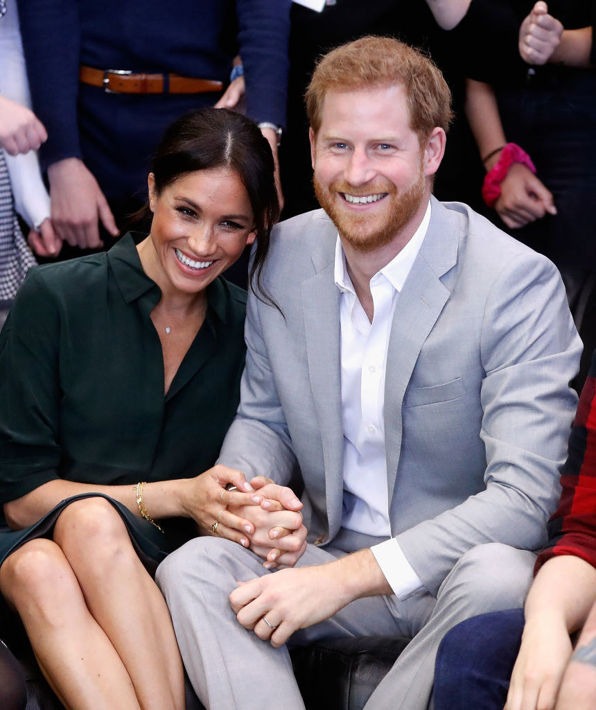 Meghan Harry hold hands on an official visit to the Joff Youth Centre in Peacehaven, Sussex